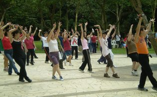 Group dancing at Pill Box event site