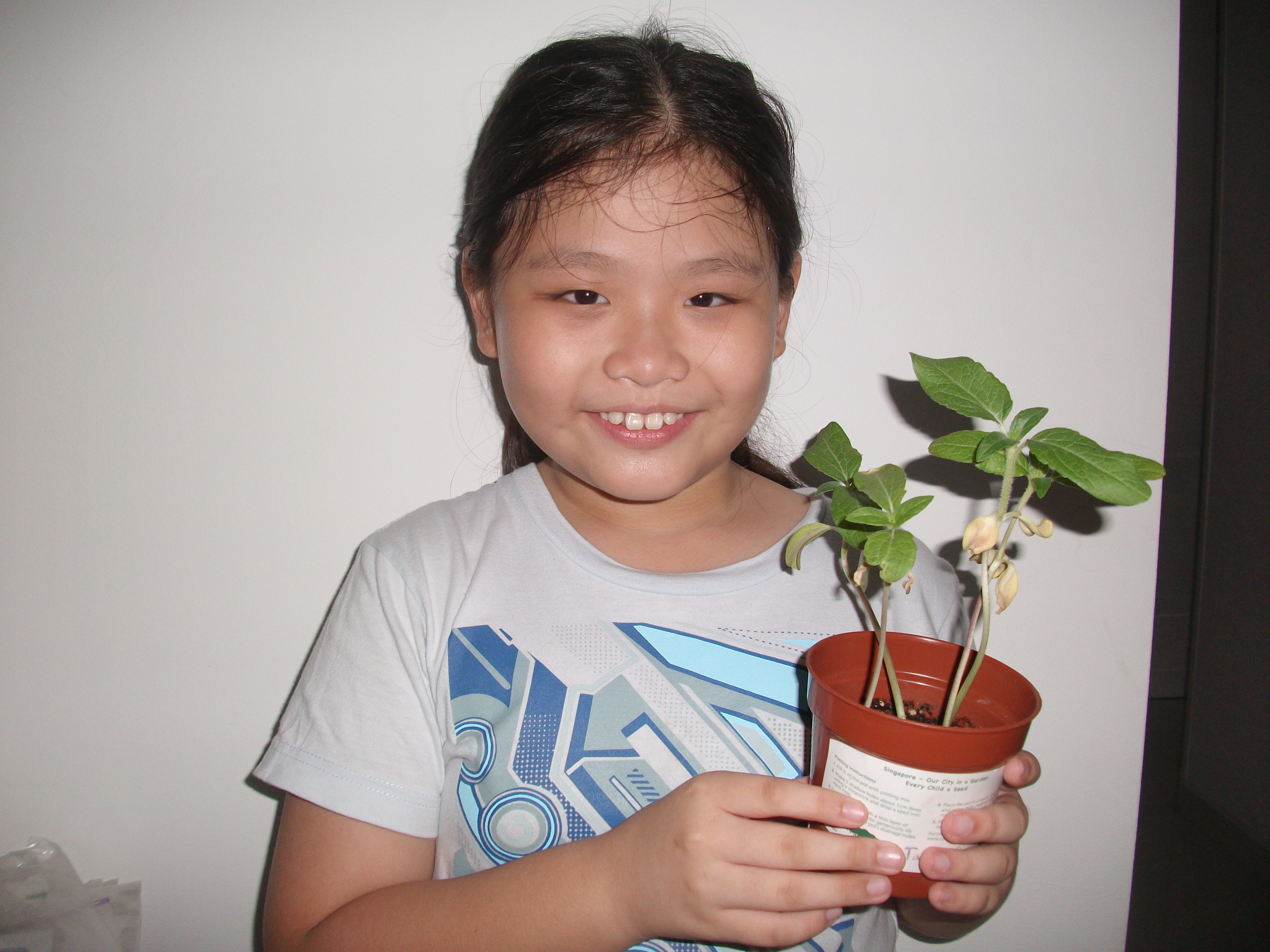 Yun Qi with plant