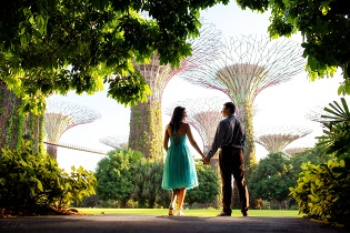 Wedding couple strolling through the Gardens by the Bay