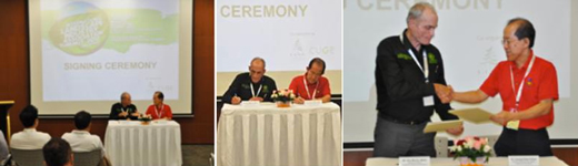 Signing Ceremony - Dr Leong Chee Chiew, DCEO, NParks and Mr Kim Morris, President of AIH